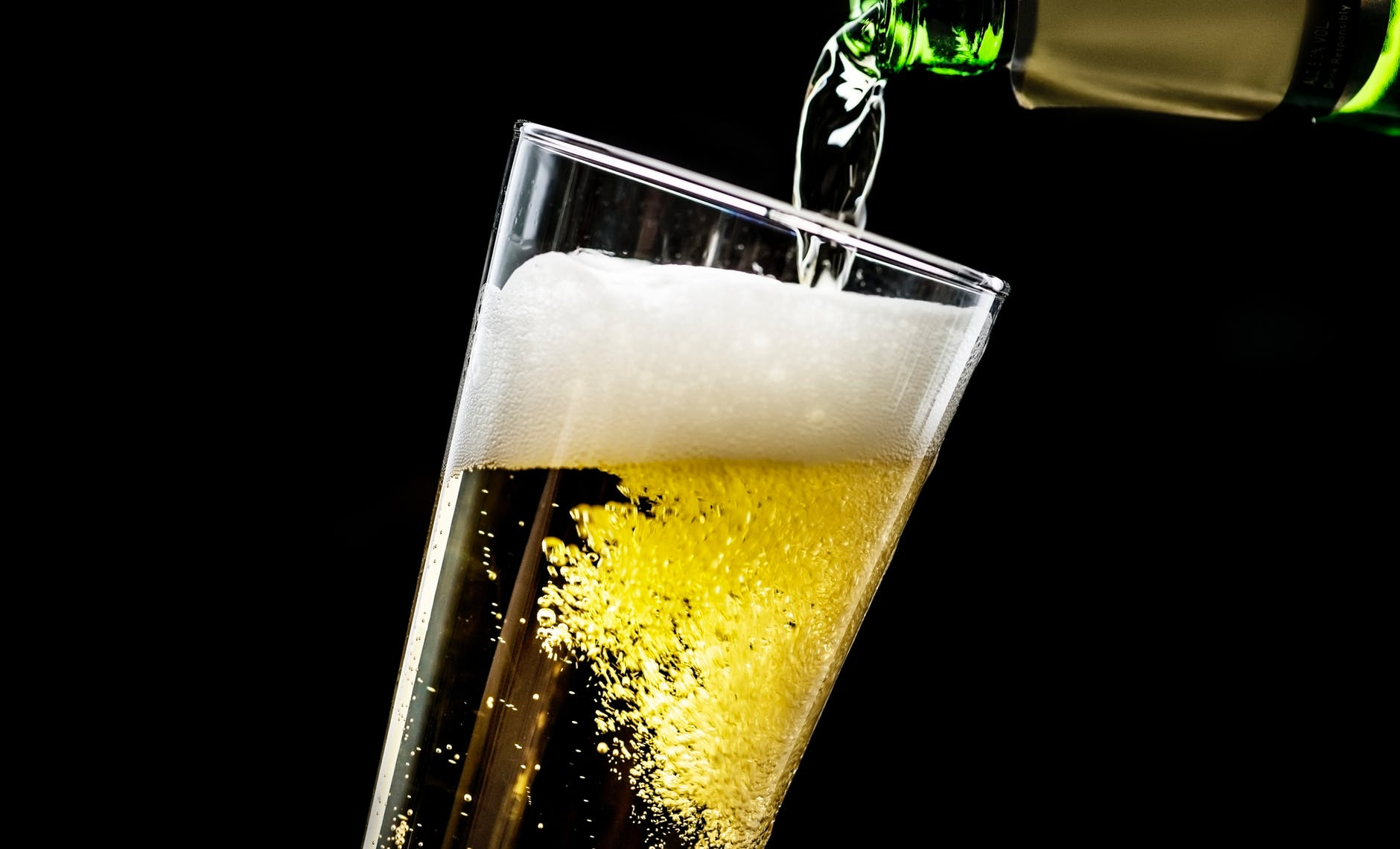 beer pouring into glass cup
